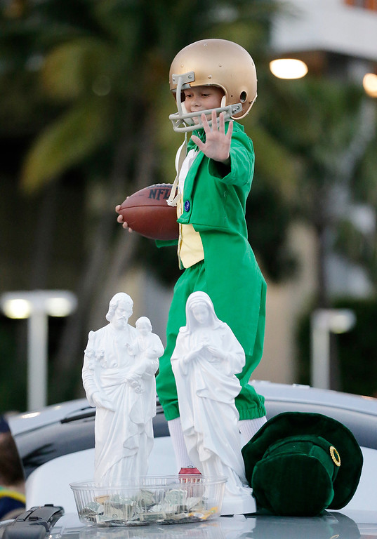 Description of . Kevin O'Sullivan poses outside Sun Life Stadium before the BCS National Championship college football game between the Alabama and the Notre Dame Monday, Jan. 7, 2013, in Miami. (AP Photo/David J. Phillip)