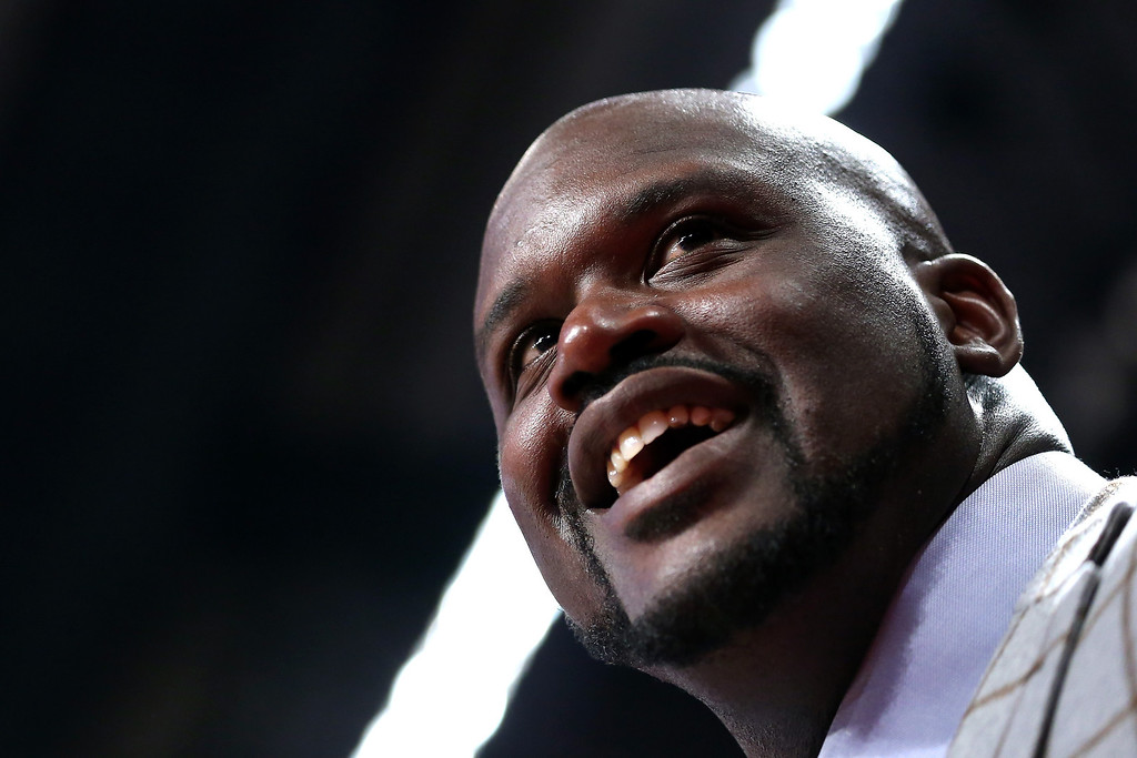 Description of . HOUSTON, TX - FEBRUARY 15:  Head coach Shaquille O'Neal of Team Shaq smiles in the BBVA Rising Stars Challenge 2013 part of the 2013 NBA All-Star Weekend at the Toyota Center on February 15, 2013 in Houston, Texas.  (Photo by Ronald Martinez/Getty Images)