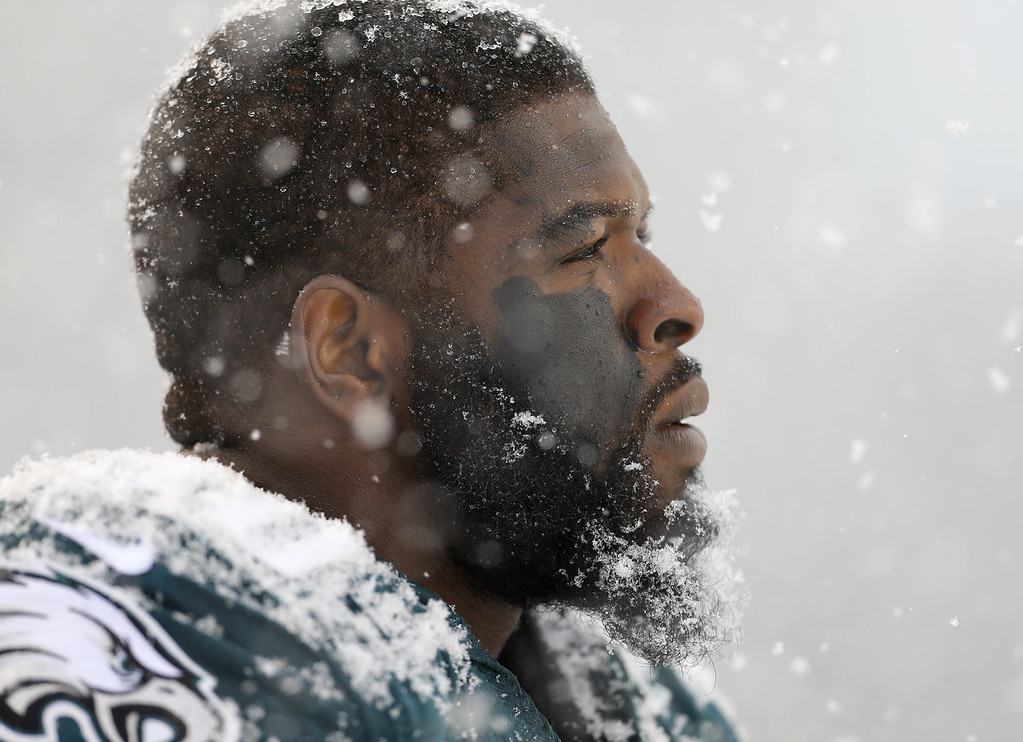 Description of . Defensive end Clifton Geathers #90 of the Philadelphia Eagles looks on from the sidelines in the first half during a game against the Detroit Lions  at Lincoln Financial Field on December 8, 2013 in Philadelphia, Pennsylvania. (Photo by Rich Schultz /Getty Images)