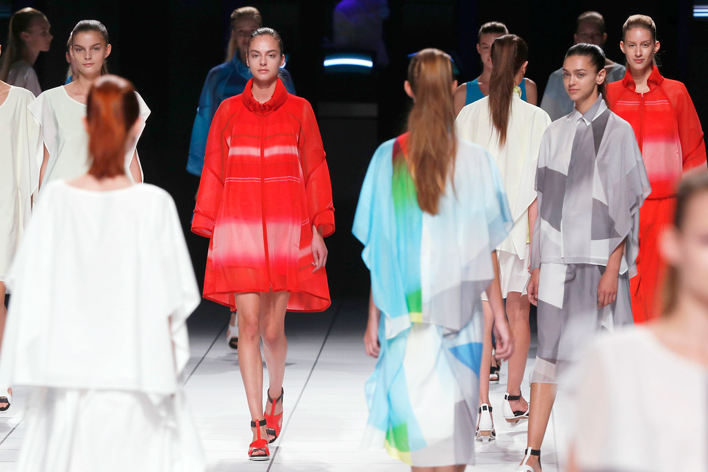 Description of . Models present creations as part of Issey Miyake's ready-to-wear Spring/Summer 2014 fashion collection, presented Friday, Sept. 27, 2013 in Paris. (AP Photo/Jacques Brinon)