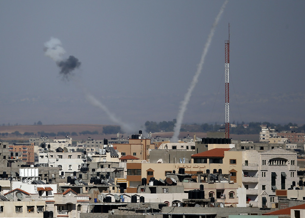 Description of . Smoke from rockets fired from a northern neighborhood of Gaza City are seen after being launched toward Israel on July 17, 2014. Israeli air strikes in Gaza killed four children, medics said, after a humanitarian lull in a 10-day conflict that has killed 237 Palestinians. AFP PHOTO / THOMAS COEX/AFP/Getty Images