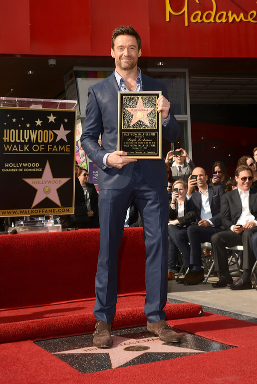 Description of . Actor Hugh Jackman is honored with a star on The Hollywood Walk Of Fame on December 13, 2012 in Hollywood, California.  (Photo by Jason Merritt/Getty Images)