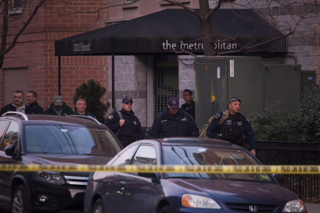 Description of . Law enforcement officials leave an apartment at 1313 Grand Street, believed be connected to the Connecticut elementary school shooting, on December 14, 2012 in Hoboken, New Jersey.  According to reports, there are 27 dead, including 20 children, after a gunman opened fire in at the Sandy Hook Elementary School in Newtown, Connecticut. The shooter, identified as Adam Lanza, was also found dead at the scene.  (Photo by Michael Nagle/Getty Images)