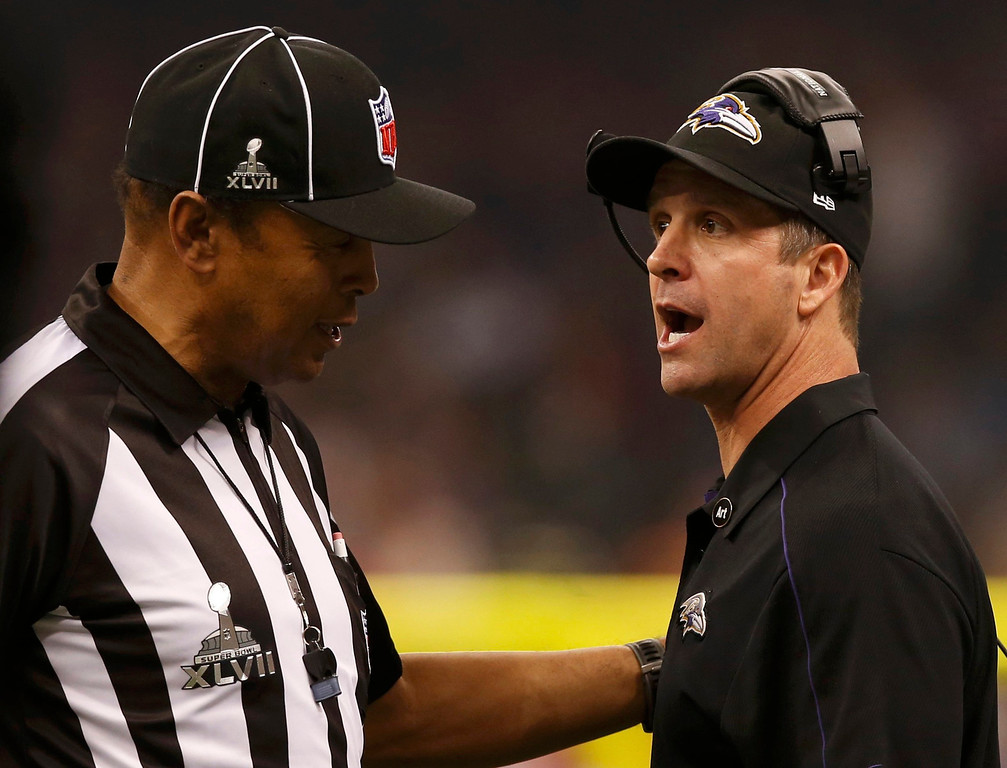 Description of . Baltimore Ravens head coach John Harbaugh talks to referee Jerome Boger as the lights return in the third quarter following a power failure in the NFL Super Bowl XLVII foorball game against the San Francisco 49ers in New Orleans, Louisiana, February 3, 2013 REUTERS/Mike Segar