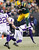 Green Bay Packers tight end Tom Crabtree (83) leaps over Minnesota Vikings cornerback A.J. Jefferson (24) during their NFL NFC wildcard playoff football game in Green Bay, Wisconsin, January 5, 2013.  REUTERS/Tom Lynn