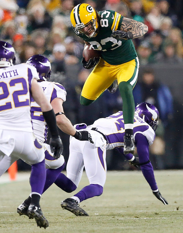 Description of . Green Bay Packers tight end Tom Crabtree (83) leaps over Minnesota Vikings cornerback A.J. Jefferson (24) during their NFL NFC wildcard playoff football game in Green Bay, Wisconsin, January 5, 2013.  REUTERS/Tom Lynn