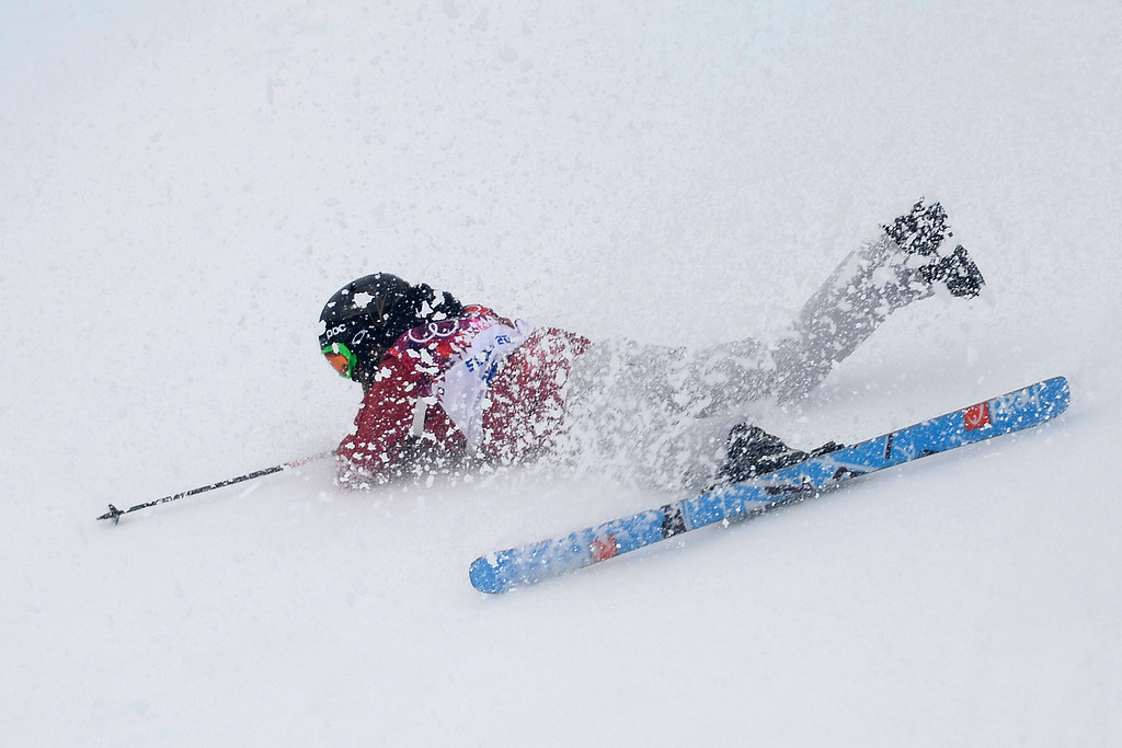 Description of . Canada\'s Yuki Tsubota crashes on her last run in the women\'s freestyle skiing slopestyle final at the Rosa Khutor Extreme Park, at the 2014 Winter Olympics, Tuesday, Feb. 11, 2014, in Krasnaya Polyana, Russia.  (AP Photo/Andy Wong)