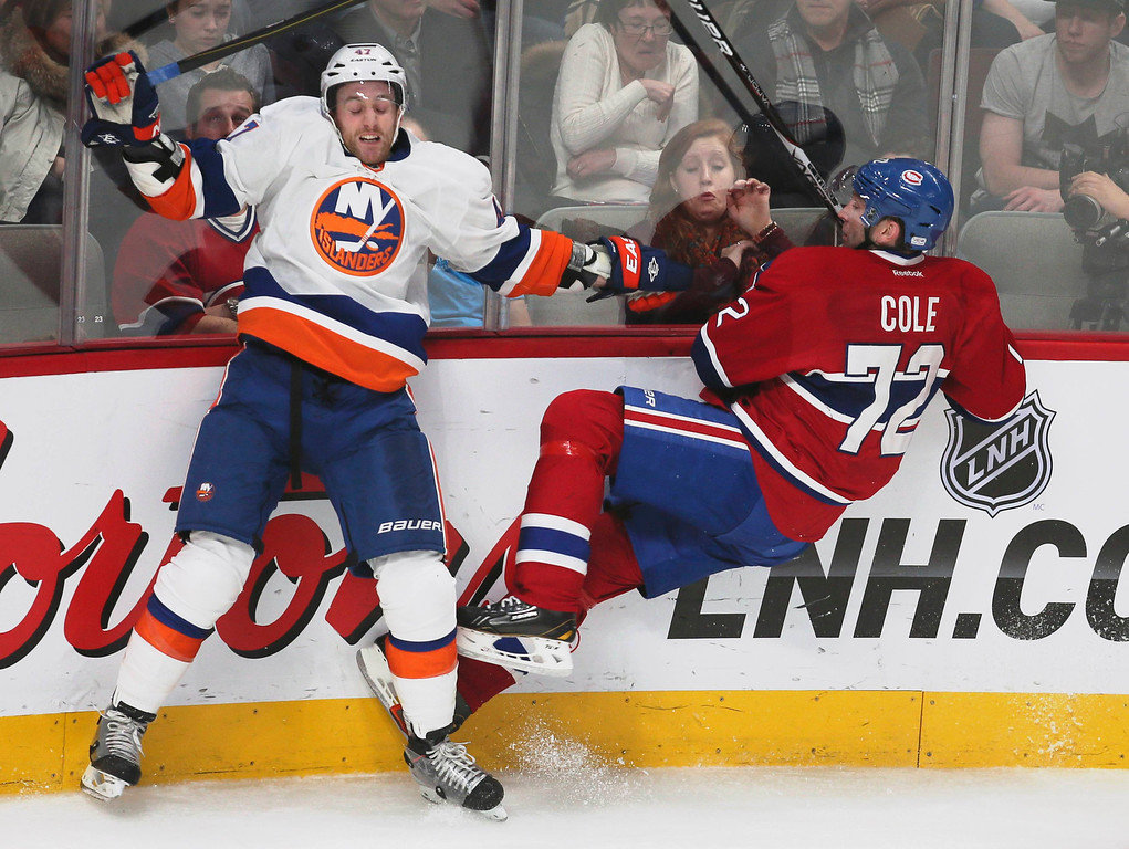 . Montreal Canadiens Erik Cole (72) and New York Islanders Andrew MacDonald (47) collide during third period NHL hockey action in Montreal, February 21, 2013.  REUTERS/Christinne Muschi