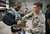 Broncos cornerback Champ Bailey gets help putting on body armor during a stop on his week-long USO/NFL tour March 16, 2013. USO Photo by Fred Greaves