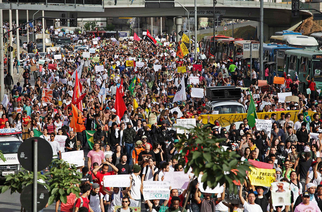 Description of . Demonstrators march toward the Mineirao Stadium, where Nigeria was playing Tahiti in the Confederations Cup, during one of the many protests around Brazil's major cities in Belo Horizonte June 17, 2013. Tens of thousands of demonstrators marched through the streets of Brazil's biggest cities on Monday in a growing protest that is tapping into widespread anger at poor public services, police violence and government corruption.  REUTERS/Pedro Vilela
