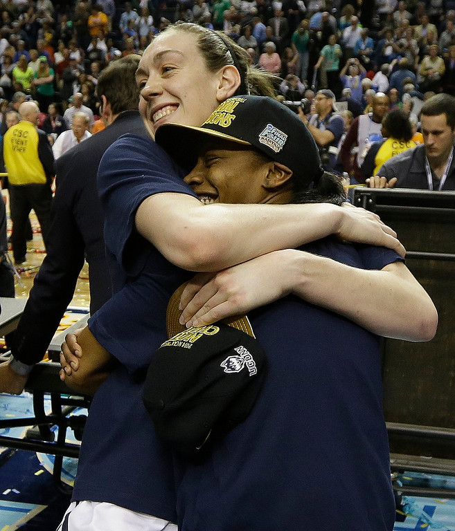 Description of . Connecticut forward Breanna Stewart (30) hugs a team mate after the second half of the championship game against Notre Dame in the Final Four of the NCAA women's college basketball tournament, Tuesday, April 8, 2014, in Nashville, Tenn. Connecticut won 79-58. (AP Photo/Mark Humphrey)