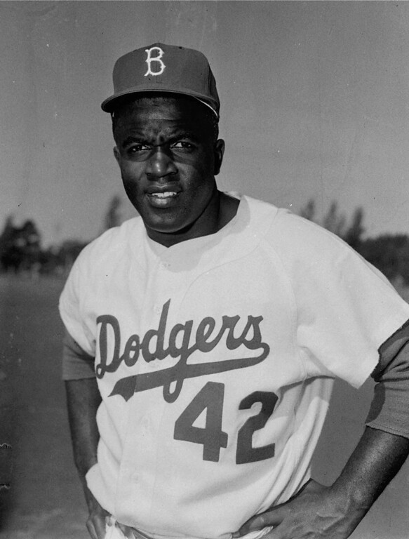 Description of . Jackie Robinson, a former Brooklyn Dodger infielder, is shown during spring training at Vero Beach, Fla., in this March 1956 file photo. (AP Photo/File)