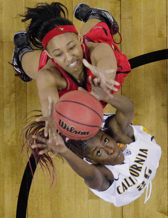 Description of . California forward Gennifer Brandon (25) and Louisville forward Cortnee Walton (13) go after a rebound in the second half of a national semifinal at the Women's Final Four of the NCAA college basketball tournament, Sunday, April 7, 2013, in New Orleans. (AP Photo/Dave Martin)