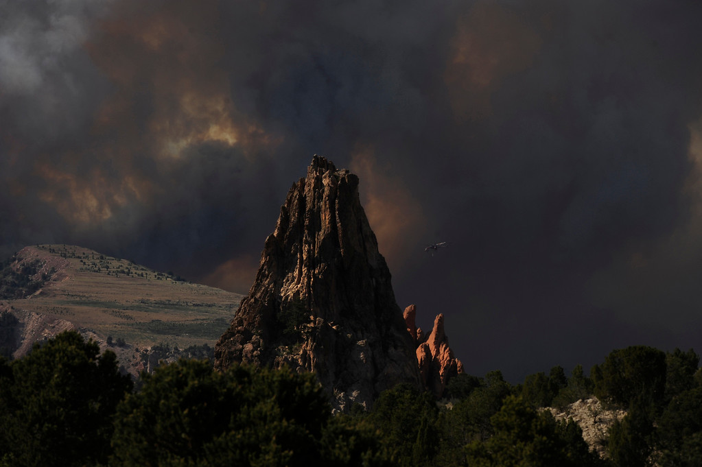 Description of . The Waldo Canyon Fire continued to grow on Tuesday, June 26, 2012, near the Garden of the Gods in Colorado Springs. RJ Sangosti, The Denver Post