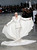 American model and actress Carmen Dell'Oresice, 82, presents a creation by French fashion designer Stephane Rolland for his Spring Summer 2013 Haute Couture fashion collection, presented in Paris, Tuesday, Jan.22, 2013. (AP Photo/Christophe Ena)