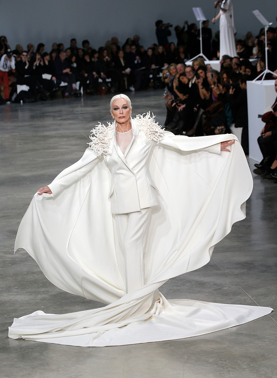 Description of . American model and actress Carmen Dell'Oresice, 82, presents a creation by French fashion designer Stephane Rolland for his Spring Summer 2013 Haute Couture fashion collection, presented in Paris, Tuesday, Jan.22, 2013. (AP Photo/Christophe Ena)