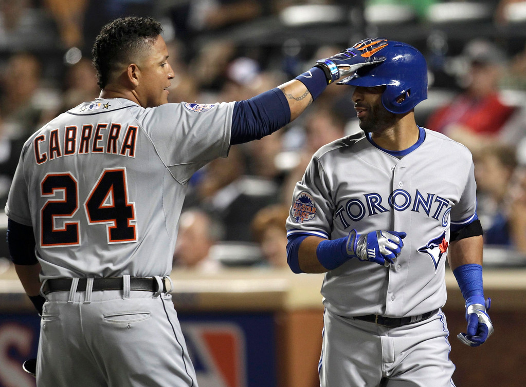 Description of . American League's Miguel Cabrera (L), of the Detroit Tigers, celebrates scoring on a sacrifice fly by Jose Bautista (R) of the Toronto Blue Jays in the fourth inning during Major League Baseball's All-Star Game in New York, July 16, 2013.  REUTERS/Shannon Stapleton