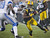 GREEN BAY, WI - DECEMBER 9:  Randall Cobb #18 of the Green Bay Packers breaks through a tackle by Don Carey #32 of the Detroit Lions at Lambeau Field on December 9, 2012 in Green Bay, Wisconsin.  (Photo by Tom Lynn /Getty Images)