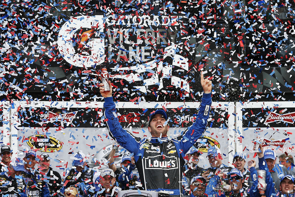 . Jimmie Johnson, driver of the #48 Lowe\'s Chevrolet, celebrates in victory lane after winning the NASCAR Sprint Cup Series Daytona 500 at Daytona International Speedway on February 24, 2013 in Daytona Beach, Florida.  (Photo by Chris Graythen/Getty Images)