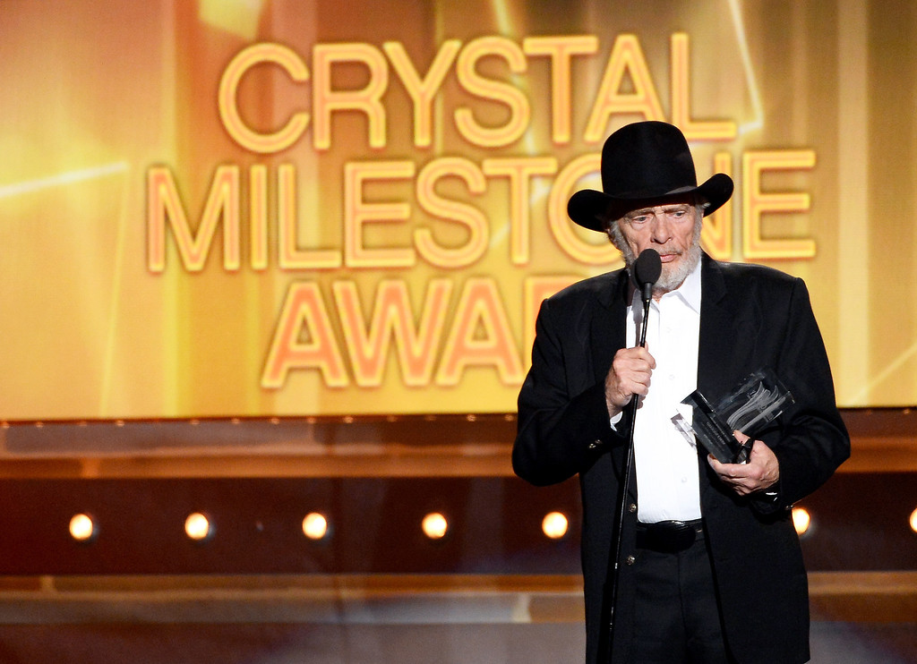 Description of . Singer/songwriter Merle Haggard accepts the ACM Crystal Milestone Award onstage during the 49th Annual Academy Of Country Music Awards at the MGM Grand Garden Arena on April 6, 2014 in Las Vegas, Nevada.  (Photo by Ethan Miller/Getty Images)