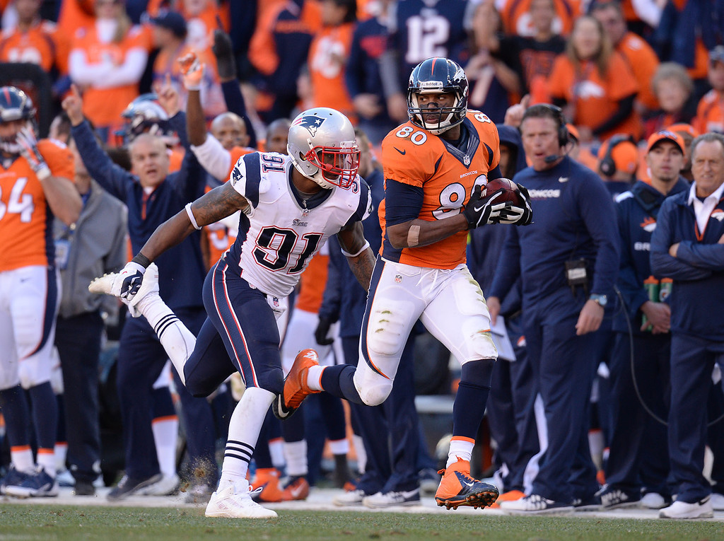 Description of . Denver Broncos tight end Julius Thomas (80) makes a catch in the fourth quarter. The Denver Broncos take on the New England Patriots in the AFC Championship game at Sports Authority Field at Mile High in Denver on January 19, 2014. (Photo by Hyoung Chang/The Denver Post)