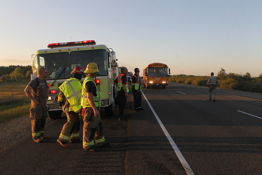 Description of . A school bus arrives to transport victims to a Red Cross shelter in Orland, Calif., after a charter bus carrying high school students, a FedEx truck and a Nissan Altima crashed on Interstate 5 killing at least nine people Thursday, April 10, 2014, near Orland. Authorities said it is not yet clear what caused the crash but that it involved a tour bus, a FedEx truck and a Nissan Altima. (AP Photo/The Record Searchlight, Greg Barnette)