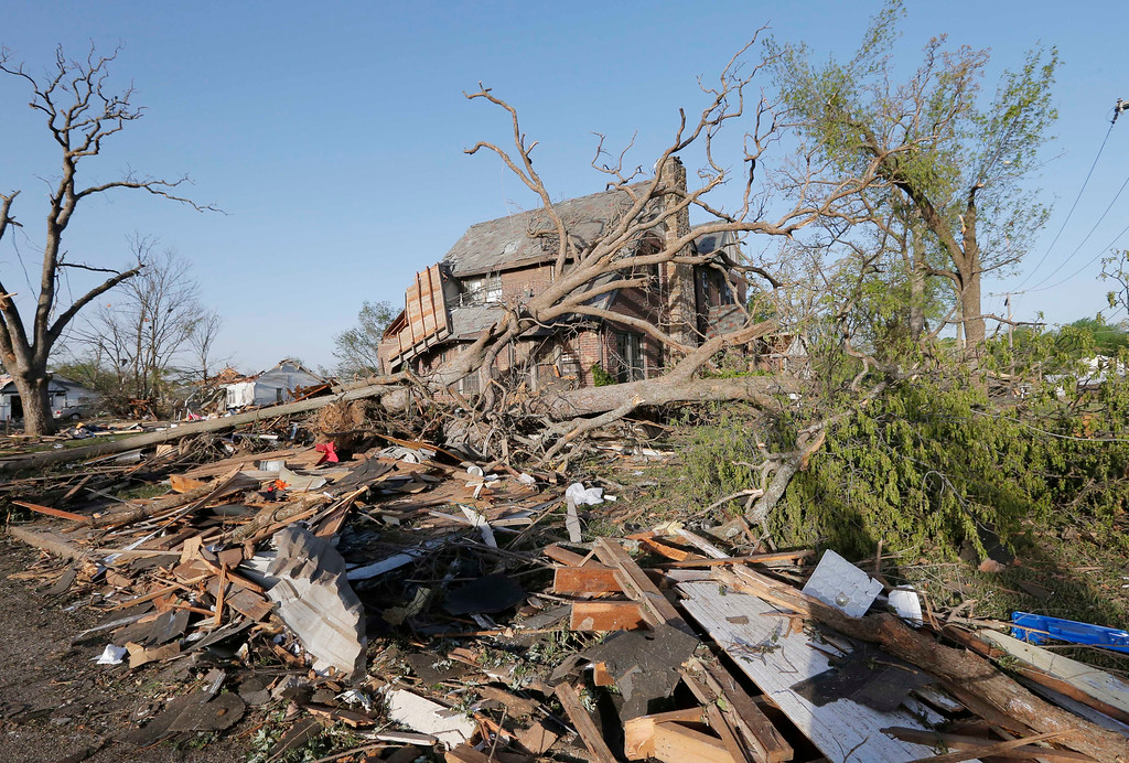 Description of . A home is covered by debris from a tornado in Baxter Springs, Kan., Monday, April 28, 2014. Sunday's tornado damaged dozens of buildings and injured at least 25 people. (AP Photo/Orlin Wagner)