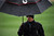MARANA, AZ - FEBRUARY 20:  Alex Noren of Sweden stands under an umbrella as snow and rain falls during the first round of the World Golf Championships - Accenture Match Play at the Golf Club at Dove Mountain on February 20, 2013 in Marana, Arizona. Play was suspended due to weather. (Photo by Stuart Franklin/Getty Images)