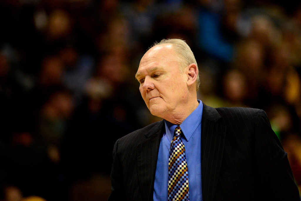 Description of . Denver Nuggets head coach George Karl takes a moment against the Golden State Warriors during the second half of the Nuggets' 116-105 win at the Pepsi Center on Sunday, January 13, 2013. AAron Ontiveroz, The Denver Post