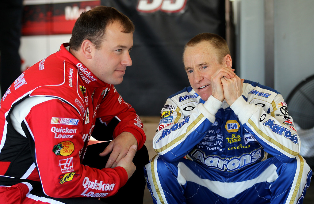 . DAYTONA BEACH, FL - FEBRUARY 20:  Ryan Newman (L), driver of the #39 Quicken Loans Chevrolet, talks with Mark Martin (R), driver of the #55 Aaron\'s Dream Machine Toyota, in the garage during practice for the NASCAR Sprint Cup Series Daytona 500 at Daytona International Speedway on February 20, 2013 in Daytona Beach, Florida.  (Photo by Todd Warshaw/Getty Images)