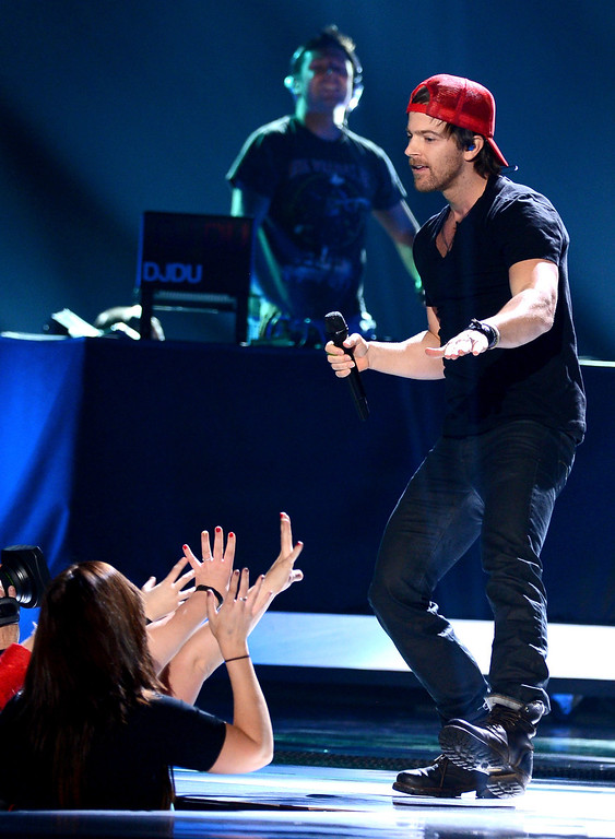 Description of . LAS VEGAS, NV - DECEMBER 10:  Singer Kip Moore performs onstage during the 2012 American Country Awards at the Mandalay Bay Events Center on December 10, 2012 in Las Vegas, Nevada.  (Photo by Mark Davis/Getty Images)