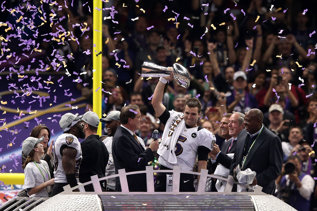 Description of . Super Bowl MVP Joe Flacco #5 of the Baltimore Ravens celebrates with the Vince Lombardi trophy after the Ravens won 34-31 against the San Francisco 49ers during Super Bowl XLVII at the Mercedes-Benz Superdome on February 3, 2013 in New Orleans, Louisiana.  (Photo by Win McNamee/Getty Images)