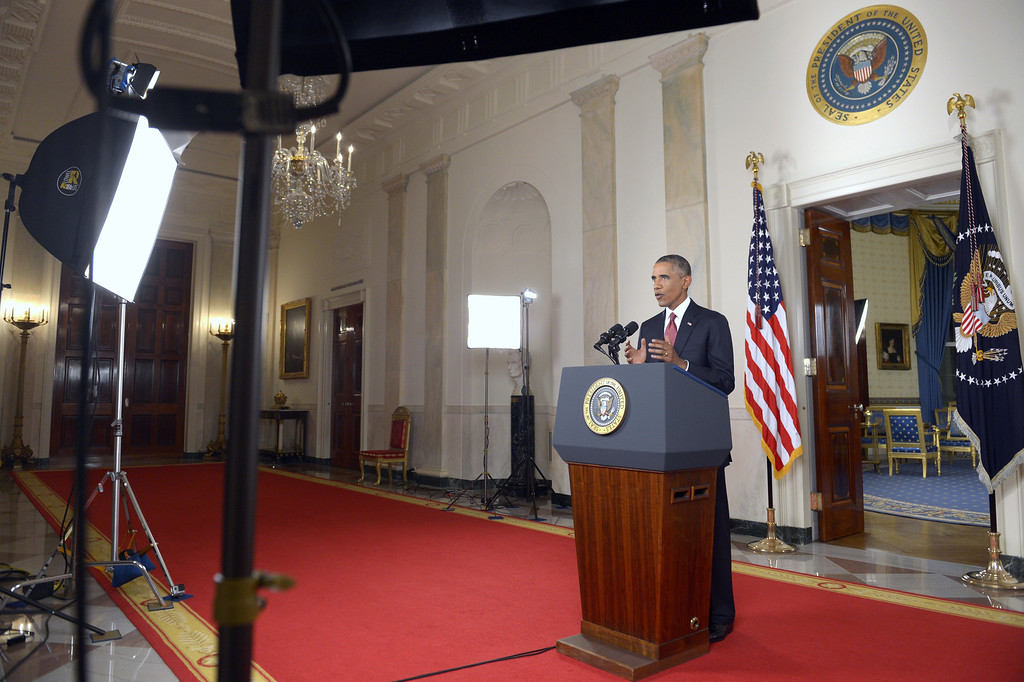 Description of . President Barack Obama addresses the nation from the Cross Hall in the White House in Washington, Wednesday, Sept. 10, 2014. In a major reversal, Obama ordered the United States into a broad military campaign to ìdegrade and ultimately destroyî militants in two volatile Middle East nations, authorizing airstrikes inside Syria for the first time, as well as an expansion of strikes in Iraq.  (AP Photo/Saul Loeb, Pool)