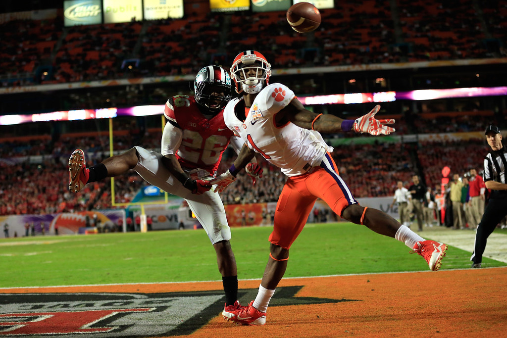 Description of . MIAMI GARDENS, FL - JANUARY 03: Martavis Bryant #1 of the Clemson Tigers catches a touchdown in the third quarter against Armani Reeves #26 of the Ohio State Buckeyes during the Discover Orange Bowl at Sun Life Stadium on January 3, 2014 in Miami Gardens, Florida.  (Photo by Chris Trotman/Getty Images)