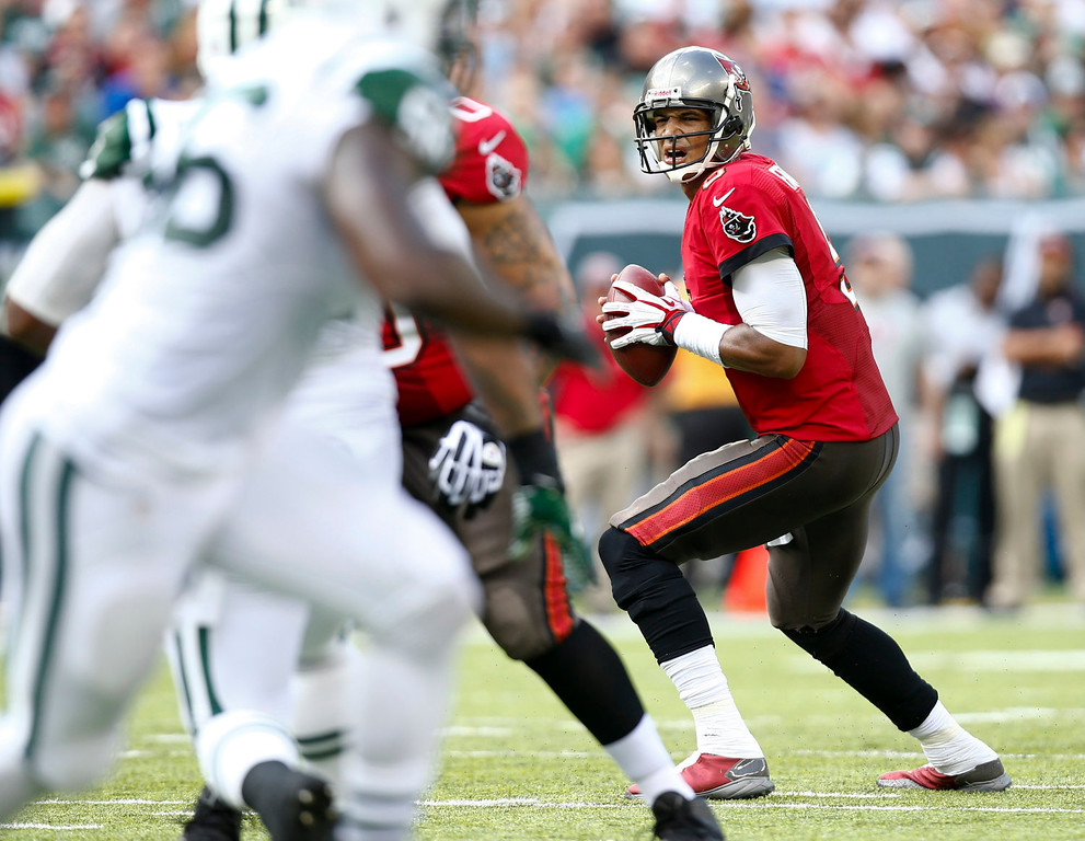 . Josh Freeman #5 of the Tampa Bay Buccaneers looks for an open man against the New York Jets during their game at MetLife Stadium on September 8, 2013 in East Rutherford, New Jersey.  (Photo by Jeff Zelevansky/Getty Images)