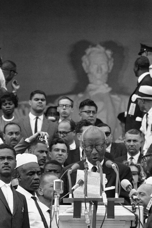 Description of . A. Philip Randolph, one of the leaders of the March on Washington demonstration, stands on crowded platform on steps of Lincoln Memorial as he speaks to crowd following the parade which brought the civil rights demonstrators to the memorial area in Washington, August 28, 1963. (AP Photo)