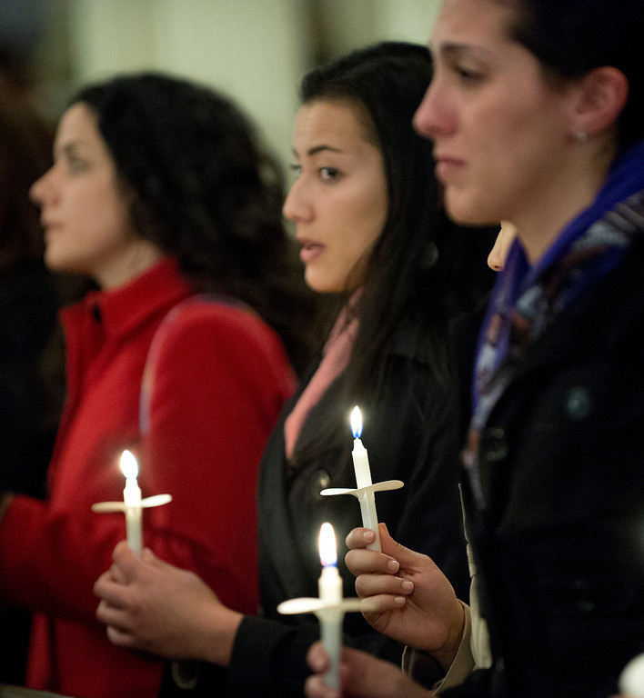 Description of . Mourners in the Arlington Street Church gather for a candle light vigil April 16, 2013 in Boston. Several hundred people gathered to remember the victims of the bombing during the running of the Boston Marathon.  DON EMMERT/AFP/Getty Images