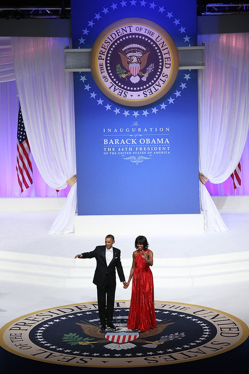 Description of . U.S. President Barack Obama (L) and first lady Michelle Obama greets attendees at the Commander-in-Chief Ball on January 21, 2013 in Washington, DC. Obama was sworn-in for his second term as president during a public ceremonial inauguration earlier in the day.  (Photo by Justin Sullivan/Getty Images)