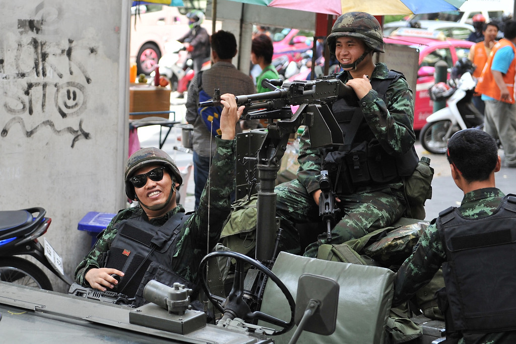 . Thai army soldiers deploy on a downtown street after martial law was declared on May 20, 2014 in Bangkok, Thailand. The army imposed martial law across Thailand amid a deepening political crisis that has seen six months of protests and claimed at least 28 lives. (Photo by Rufus Cox/Getty Images)
