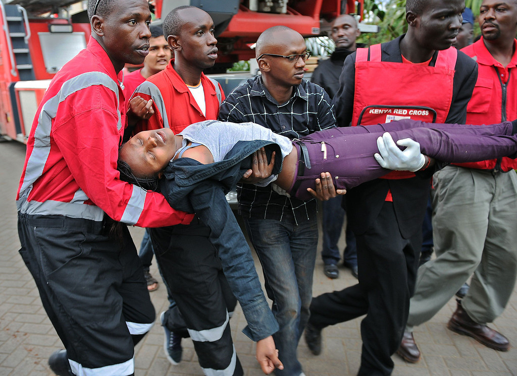 Description of . A woman who had been held hostage is carried in shock by rescue personnel on September 21, 2013, after she was freed following a security operation at an upmarket shopping mall in Nairobi where suspected terrorists engaged Kenyan security forces in a drawn out gun fight. Some 20 people have been killed and about 50 wounded Saturday in the initial attack by the gunmen the Kenya Red Cross said.  AFP PHOTO / Tony KARUMBA/AFP/Getty Images