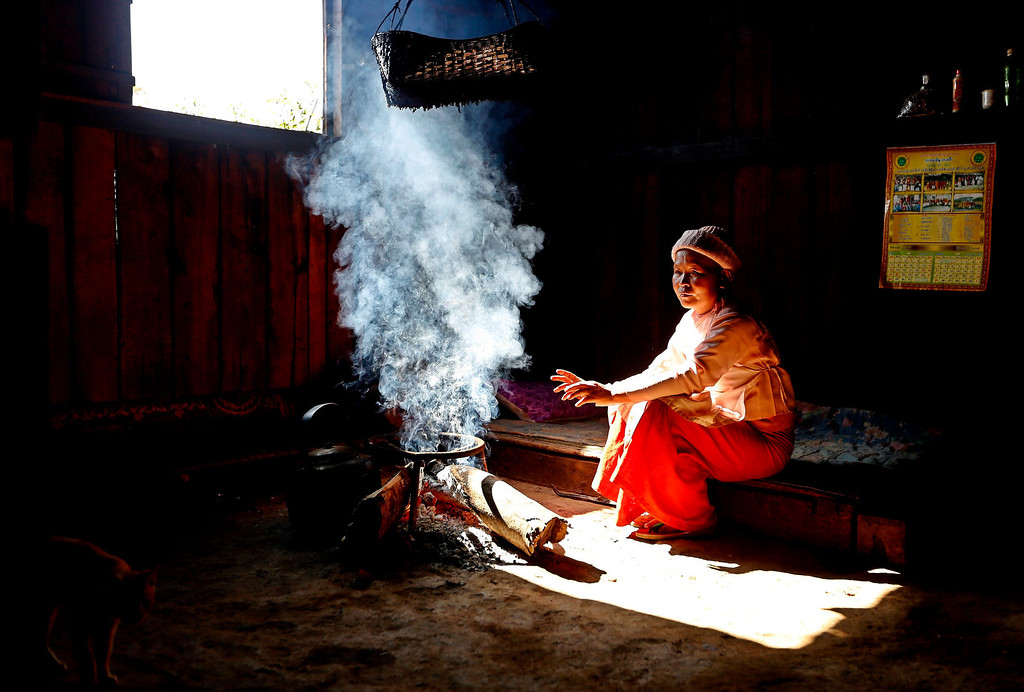 Description of . A Buddhist nun sits by the fire to keep warm in Homain village, Nansam Township, Northern Shan State, Myanmar on Jan. 13, 2014. Myanmar's opium production in 2013 was expected to reach 870 tons, a 26-per-cent increase year-on-year, for a 13-per-cent increase in cultivated area, the United Nations said. Last year, Myanmar produced an estimated 690 tons of opium, compared with 41 tons in Laos and 3 tons in Thailand, the three significant producers in South-East Asia. Myanmar was the world's largest source of opium and its derivative heroin in the early 1990s, but is now ranked second after Afghanistan. Myanmar's northern Shan State, home to several insurgencies including the Shan State Army and United Wa State Army, accounted for 92 per cent of opium poppy cultivation this year, with the remainder located in neighbouring Kachin State, where government troops and the Kachin Independence Army have been fighting since 2011, the report said.  EPA/NYEIN CHAN NAING