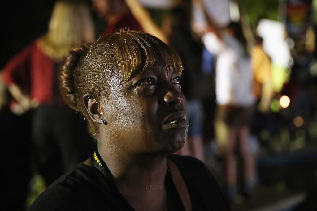 Description of . Tanetta Foster breaks into tears in front of the Seminole County Criminal Justice Center after learning George Zimmerman had been found not guilty in the Murder of Trayvon Martin on July 13, 2013 in Sanford, Florida. Zimmerman, a neighborhood watch volunteer shot and killed 17-year-old Martin after an altercation in February 2012.  (Photo by Scott Olson/Getty Images)