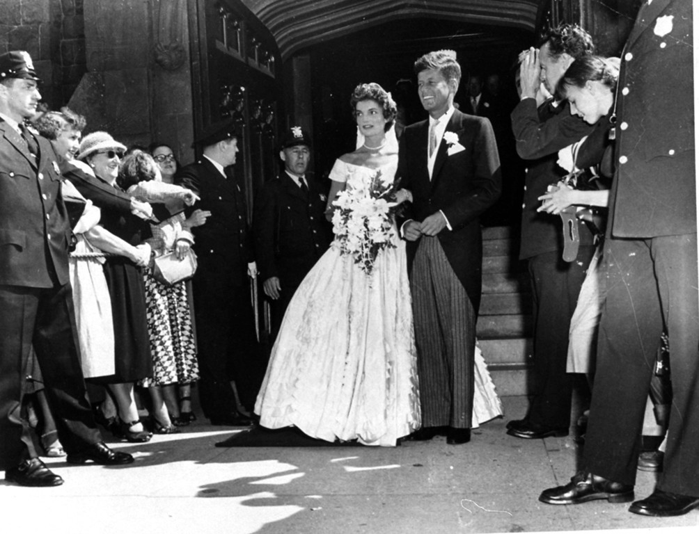 Description of . Sen. Kennedy leaves a Newport, R.I., church with his bride, the former Jacqueline Bouvier on Sept. 12, 1953.  Associated Press file