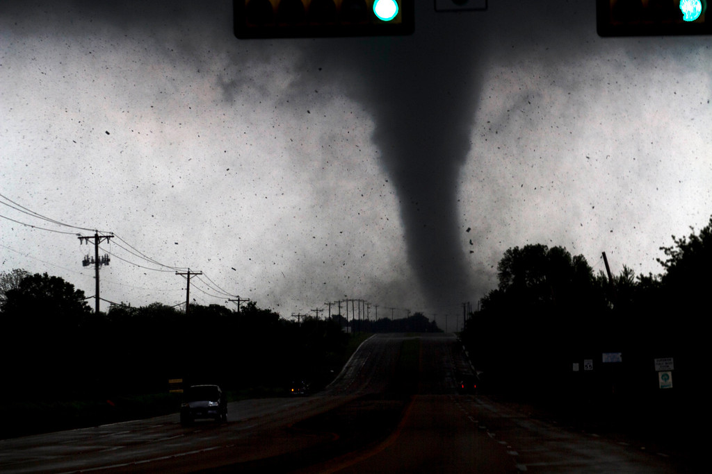 Description of . In this April 3, 2012 file photo, a tornado touches down in Lancaster, Texas, south of Dallas. Tornadoes tore through the Dallas area, peeling roofs off homes, tossing big-rig trucks into the air and leaving flattened tractor trailers strewn along highways and parking lots. (AP Photo/The Dallas Morning News, Parrish Velasco, File)
