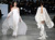 Models present creations by French fashion designer Stephane Rolland  for his Spring Summer 2013 Haute Couture fashion collection, presented in Paris, Tuesday, Jan.22, 2013. (AP Photo/Christophe Ena)