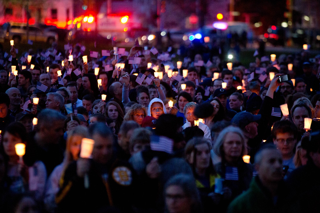 Description of . Mourners attend candlelight vigil for Martin Richard at Garvey Park, near Richard\'s home in the Dorchester section of Boston, on Tuesday, April 16, 2013. Martin is the 8-year-old boy killed in the Boston Marathon bombing. (AP Photo/The New York Times, Josh Haner)