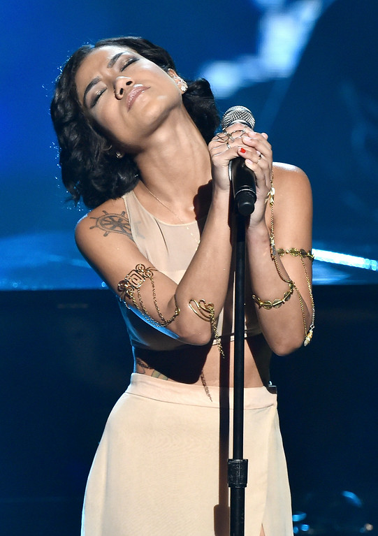 Description of . Singer Jhene Aiko performs onstage during the BET AWARDS '14 at Nokia Theatre L.A. LIVE on June 29, 2014 in Los Angeles, California.  (Photo by Kevin Winter/Getty Images for BET)