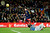 Barcelona's Lionel Messi (top) scores his second goal against Atletico de Madrid goalkeeper Thibaut Courtois during their Spanish first division soccer match at Nou Camp stadium in Barcelona December 16, 2012.     REUTERS/Gustau Nacarino