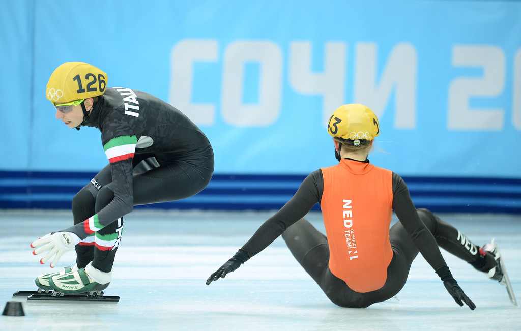 . Netherlands\' Sanne van Kerkhof (R) falls next to Italy\'s Lucia Peretti as they compete in the Women\'s Short Track 3000 m Relay Semifinals at the Iceberg Skating Palace during the Sochi Winter Olympics on February 10, 2014.   JUNG YEON-JE/AFP/Getty Images