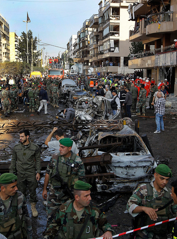 . Lebanese policemen inspect the scene of two suicide explosions near the Iranian embassy in south Beirut, Lebanon, early 19 November 2013.   EPA/NABIL MOUNZER